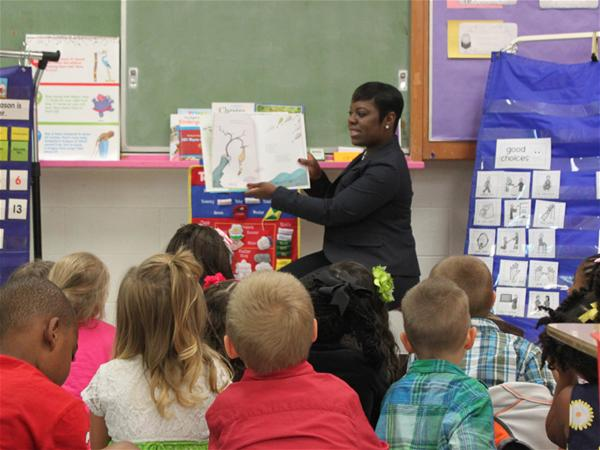 A Principal at a local elementary school reads to children